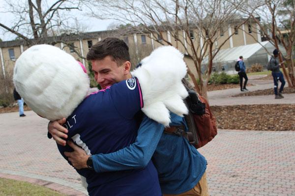 Tormenta FC Bolt Mascot Giving Hug