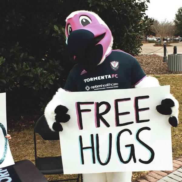 Tormenta FC Bolt Mascot Free Hugs Sign