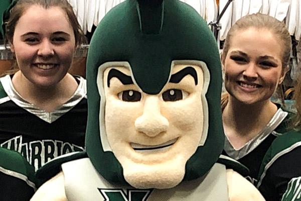 Warrior Mascot With Cheerleaders