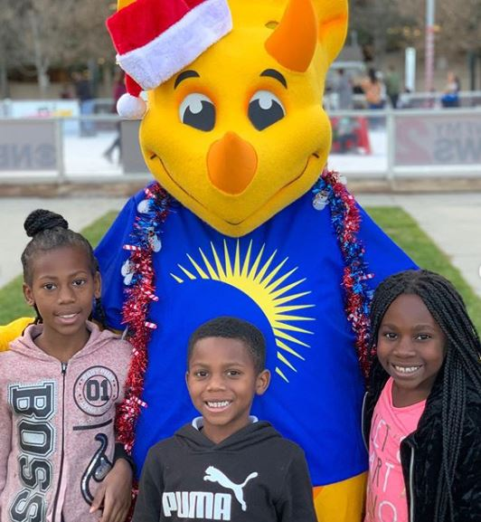 Truceratops Mascot with Kids For the Holidays