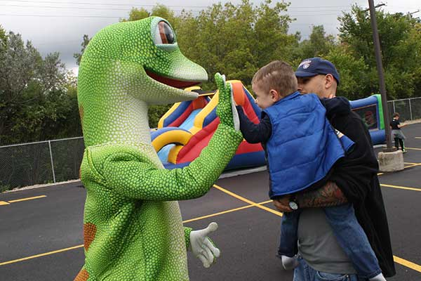 Geico Gecko Gives High Five to Child