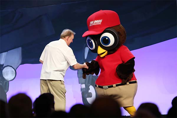 Hootie Owl Mascot Greeting Man at Conference