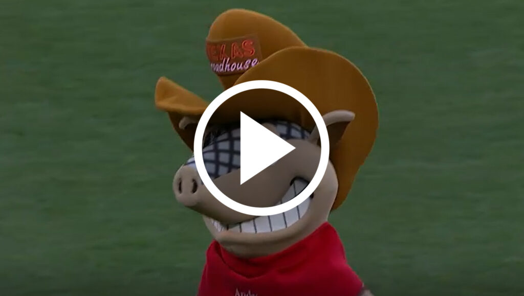 Texas Roadhouse mascot throwing out first pitch with video overlay
