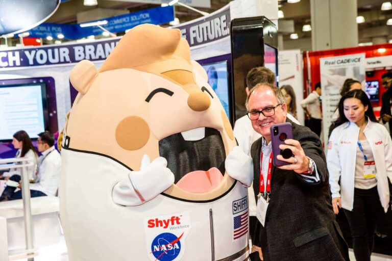 Mascot At Tradeshow Taking Selfie With Man