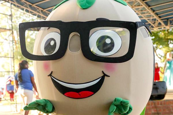 Super Soy Bean mascot wearing thick framed black glasses
