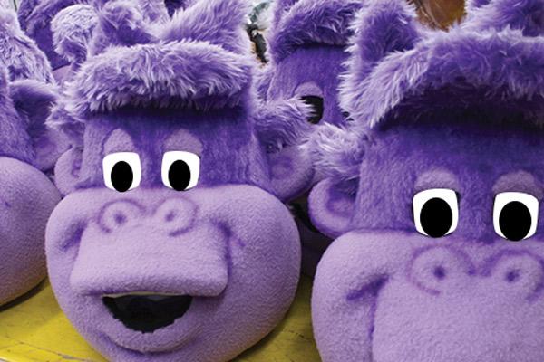 Multiple purple monkey mascot heads