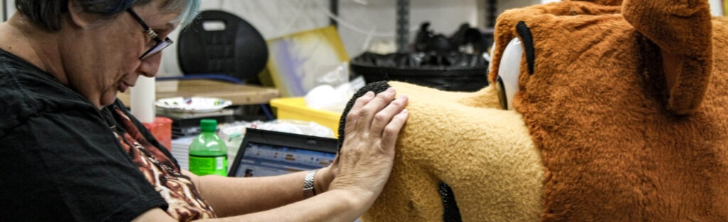 Seamstress playing with yogi bear's nose