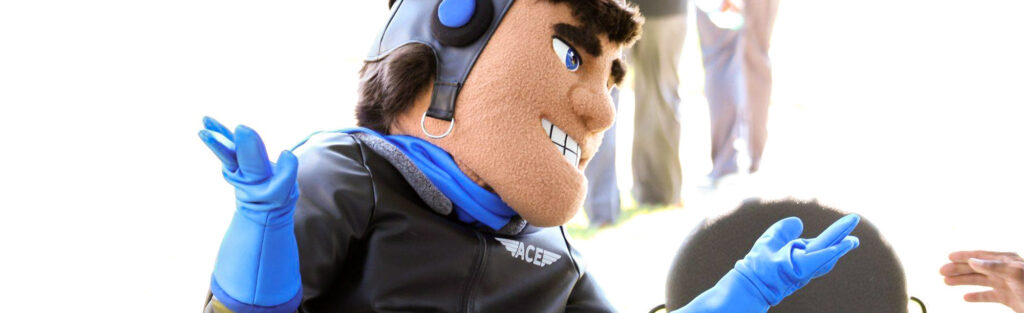 Pilot mascot shrugging in chair with head tilted