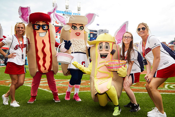 Cleveland Indian's hot dog mascots pose with fans