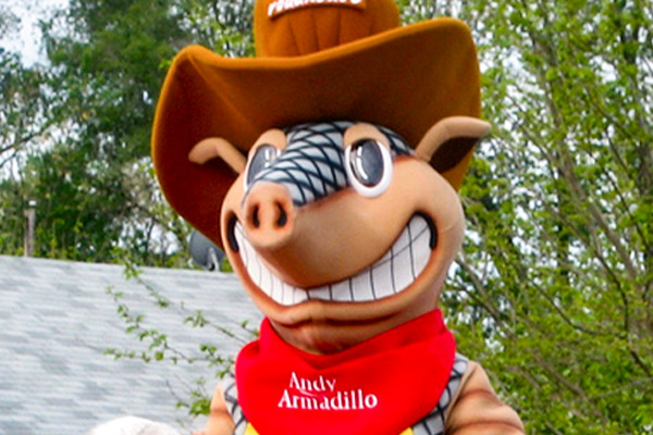 Andy Armadillo in the back of a welcoming truck in a parade