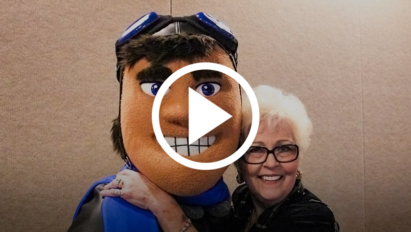 YouTube play button over man mascot image